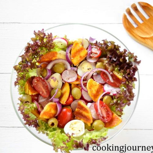 summer salad with vegetables, quail eggs and grilled cheese
