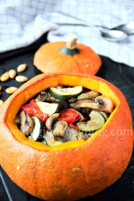 Stuffed pumpkin with baked vegetables is beautiful and healthy meal. Orange pumpkin, stuffed with zucchini, eggplant, mushrooms and bell pepper.