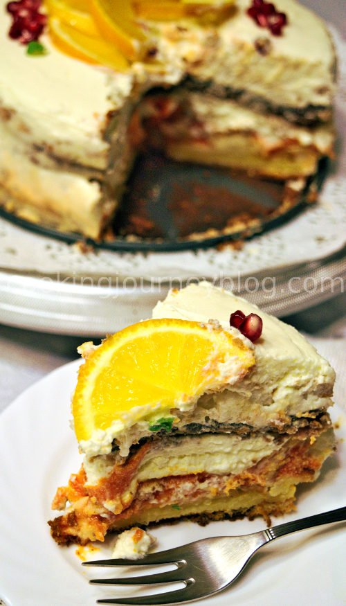 Orange cake is great birthday cake or beautiful and tasty table decoration. Chocolate sponge with crunchy pavlova, the most delicious orange jam you can imagine, and white cream frosting with a hint of rum. Beautiful rustic cake. Slice of orange cake.