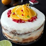 Orange cake is great birthday cake or beautiful and tasty table decoration. Chocolate sponge with crunchy pavlova, the most delicious orange jam you can imagine, and white cream frosting with a hint of rum. Beautiful rustic cake.