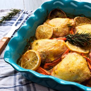 Rosemary chicken is tasty and inspiring one pot dinner to make. Chicken thighs are baked in mandarin orange sauce. Sweet and sour taste of sauce, tender rosemary chicken thighs – this dish is perfect for winter gathering with friends and family. And the color of this mandarin orange sauce is so inviting and festive! Baked chicken thighs with carrots and lemons in mandarin sauce