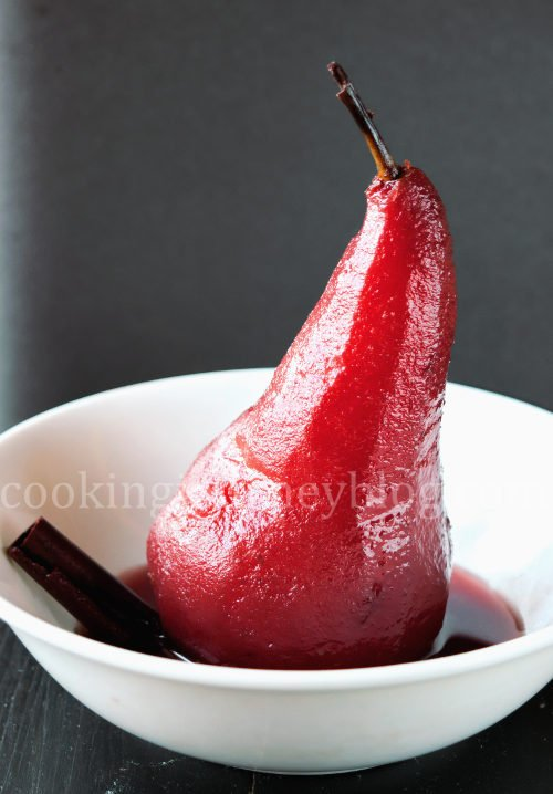 Poached pears is an easy and exquisite French dessert. This is no bake dessert, spicy poached pears in red wine. To my mind, this is one of the most beautiful pear desserts - soft fruit with spicy winter flavors. Poached pear in red wine, served on the white plate