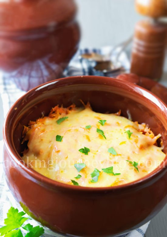 Dinner Ideas . Dinner in a clay pot. Beef and potatoes, covered with cheese and parsey.
