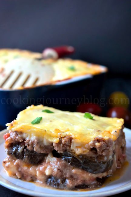 Moussaka recipe – Greek recipes - Mediterranean food . Slice of moussaka with eggplant, beef and cheese on top.