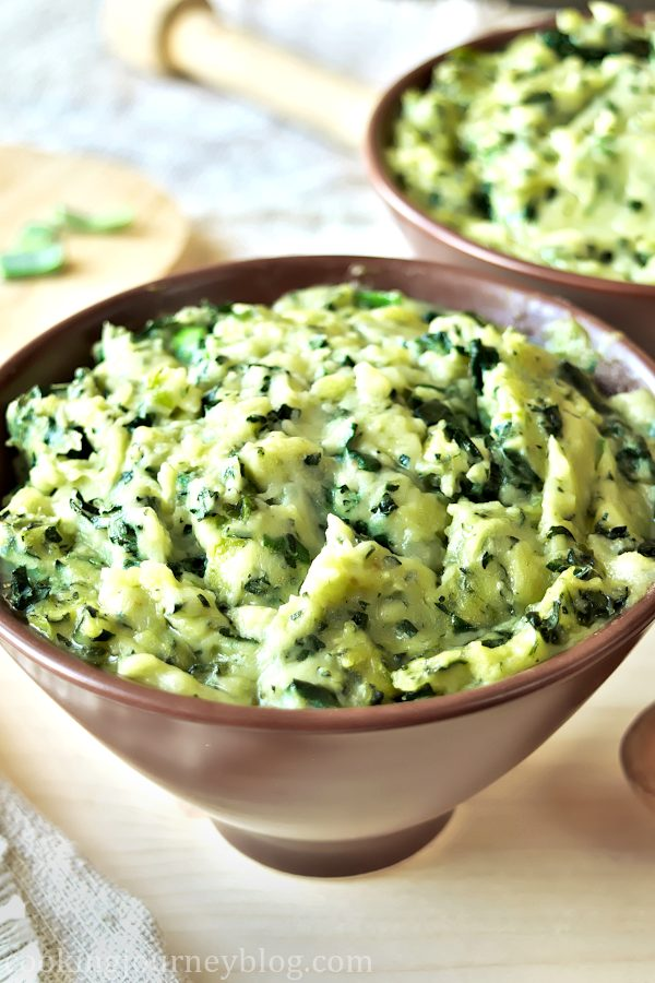 Colcannon recipe - traditional Irish food - St Patrick's day food - mashed potatoes in a bowl with wooden spoon