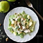 Avocado chicken salad on a white plate, view from top