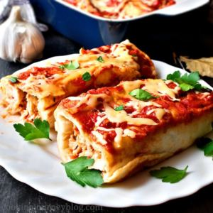 Chicken enchiladas with parsley on top