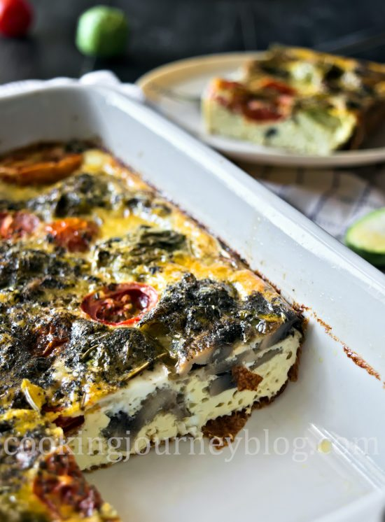 Breakfast frittata in a baking dish with Brussels sprouts, mushrooms and tomatoes