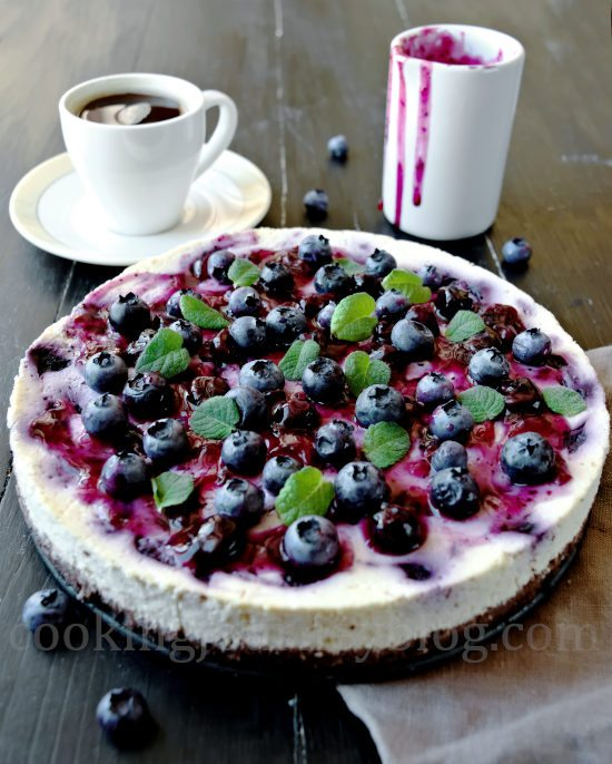 Blueberry cheesecake, served with coffee and blueberry sauce