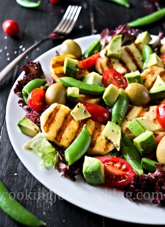 Colorful Grilled Halloumi and Avocado Salad, served on a plate, close look