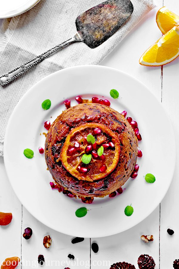 Christmas Pudding Recipe – Easy Fruit Cake. View from the top. Served with fruits and berries.