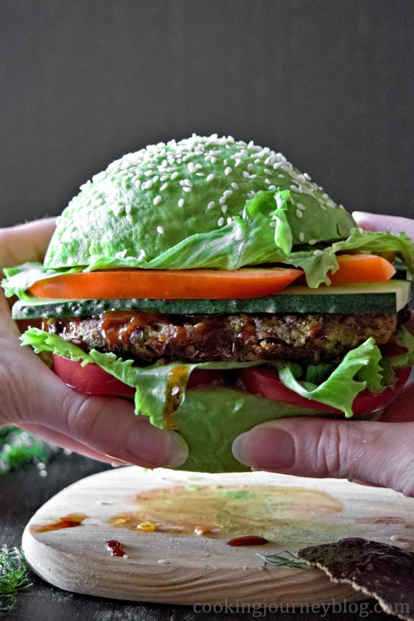 Holding vegan avocado burger