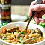 Irish Beef stew, served with parsley, garlic and a spoon