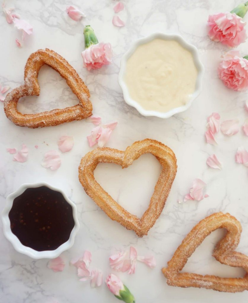 Heart shaped churros with two dipping sauces