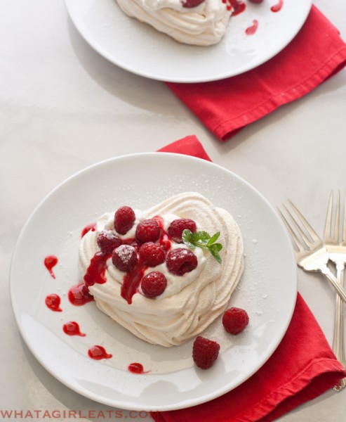 meringue hearts with whipped cream and raspberries