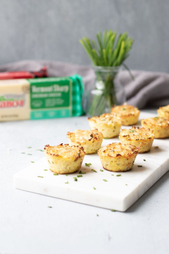 Cheddar chive cauliflower bites on a serving board