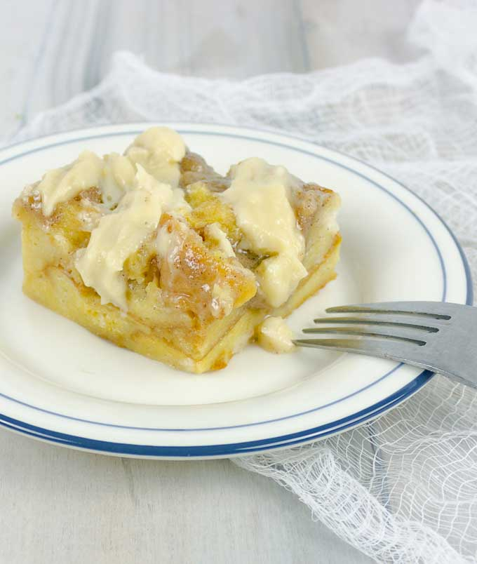 Irish Cream Custard Bread Pudding served on a white plate and a fork
