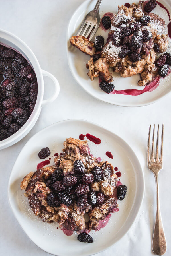 German pancakes on a plate with blackberries