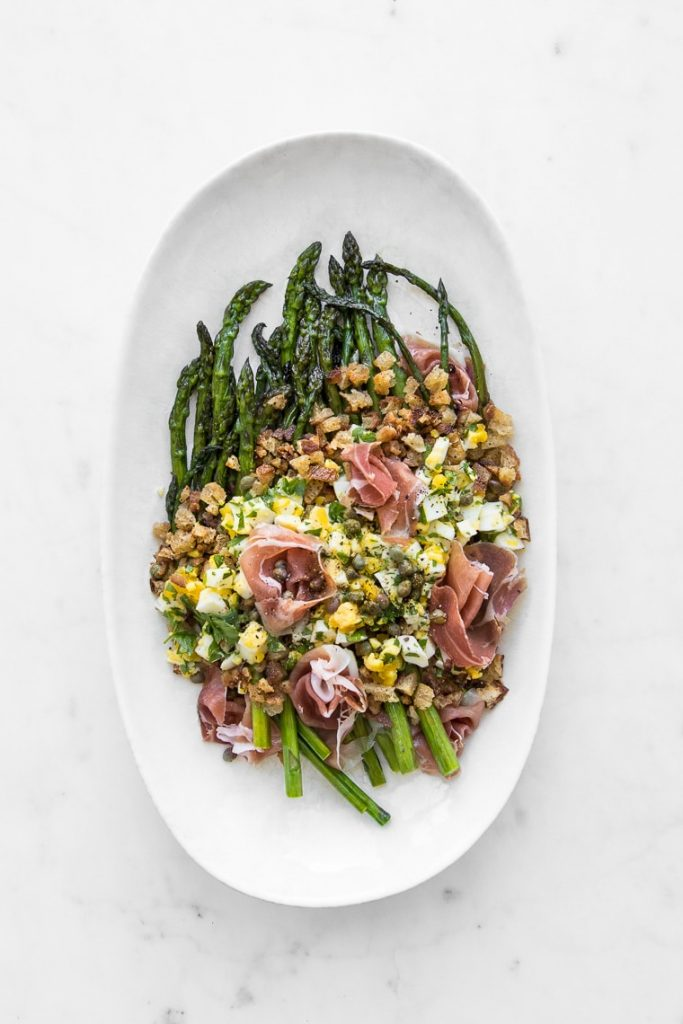 polonaise asparagus salad served on a white plate