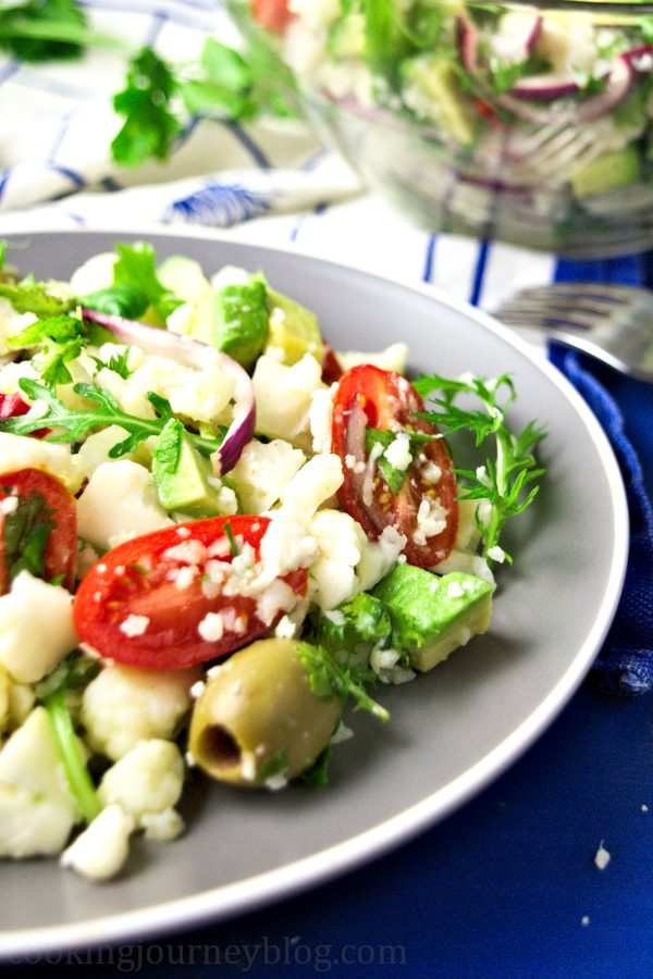 Vegan Cauliflower Salad in the bowl, served with forks and lime