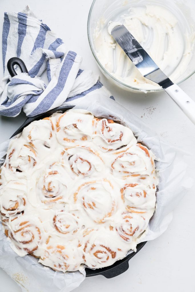 Glazed cinnamon rolls in a pan