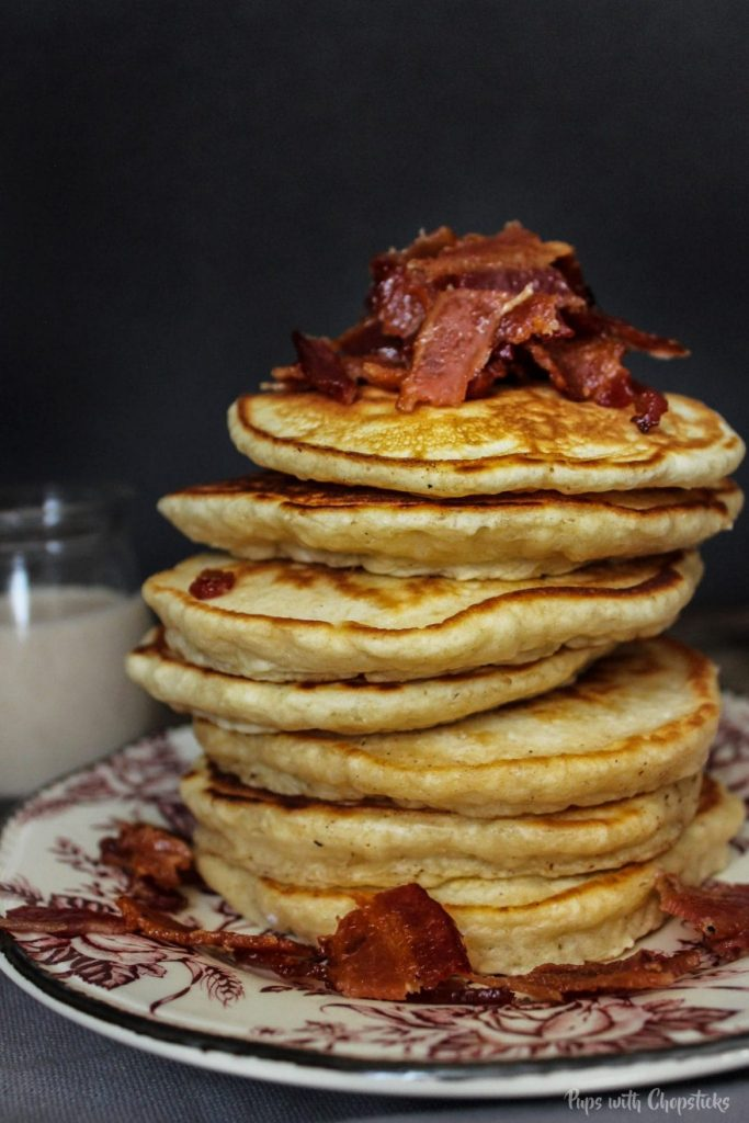 Pancakes stack with bacon on top