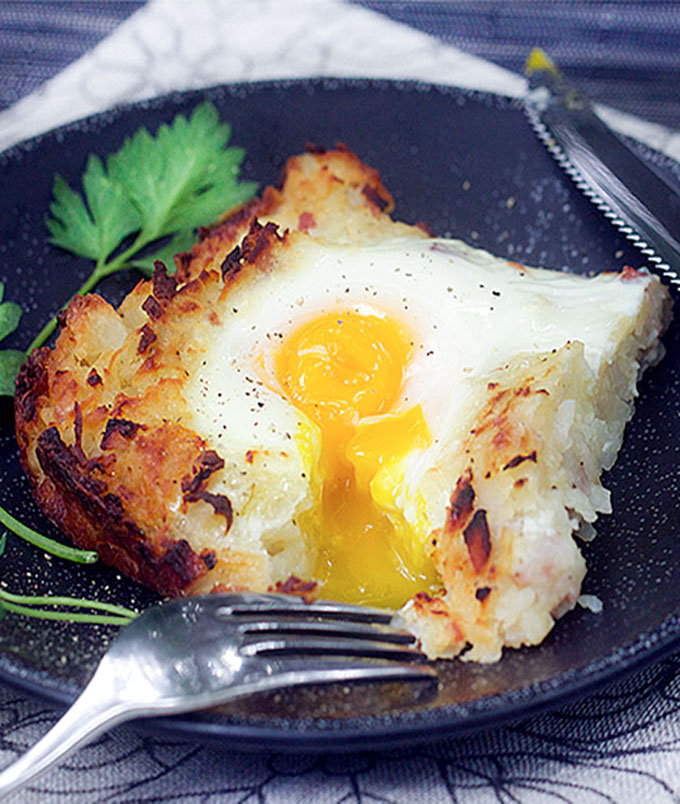 Rösti potato casserole on a plate with running egg on top