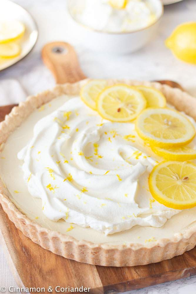 Lemon tart, served with whipped topping and lemon slices