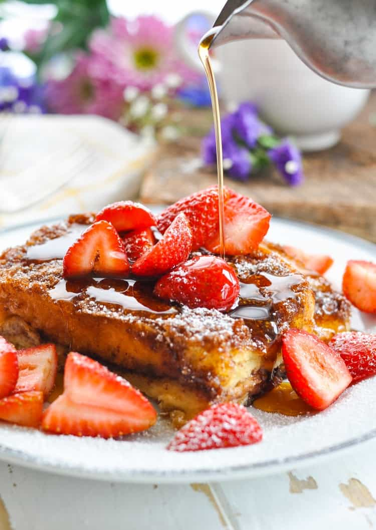 Dump-and-Bake Easy French Toast Casserole, served on the plate with strawberries