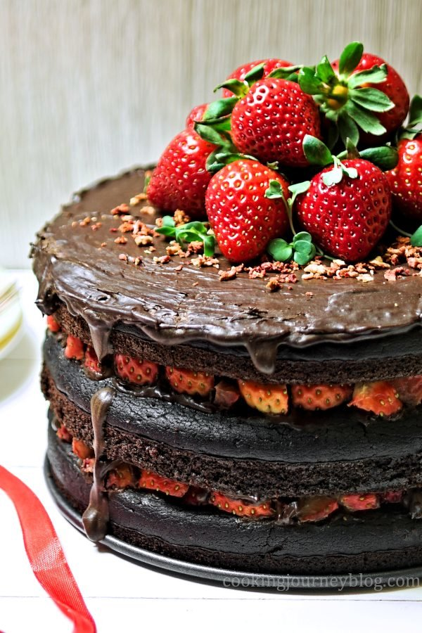 Vegan chocolate cake with strawberries and chocolate frosting