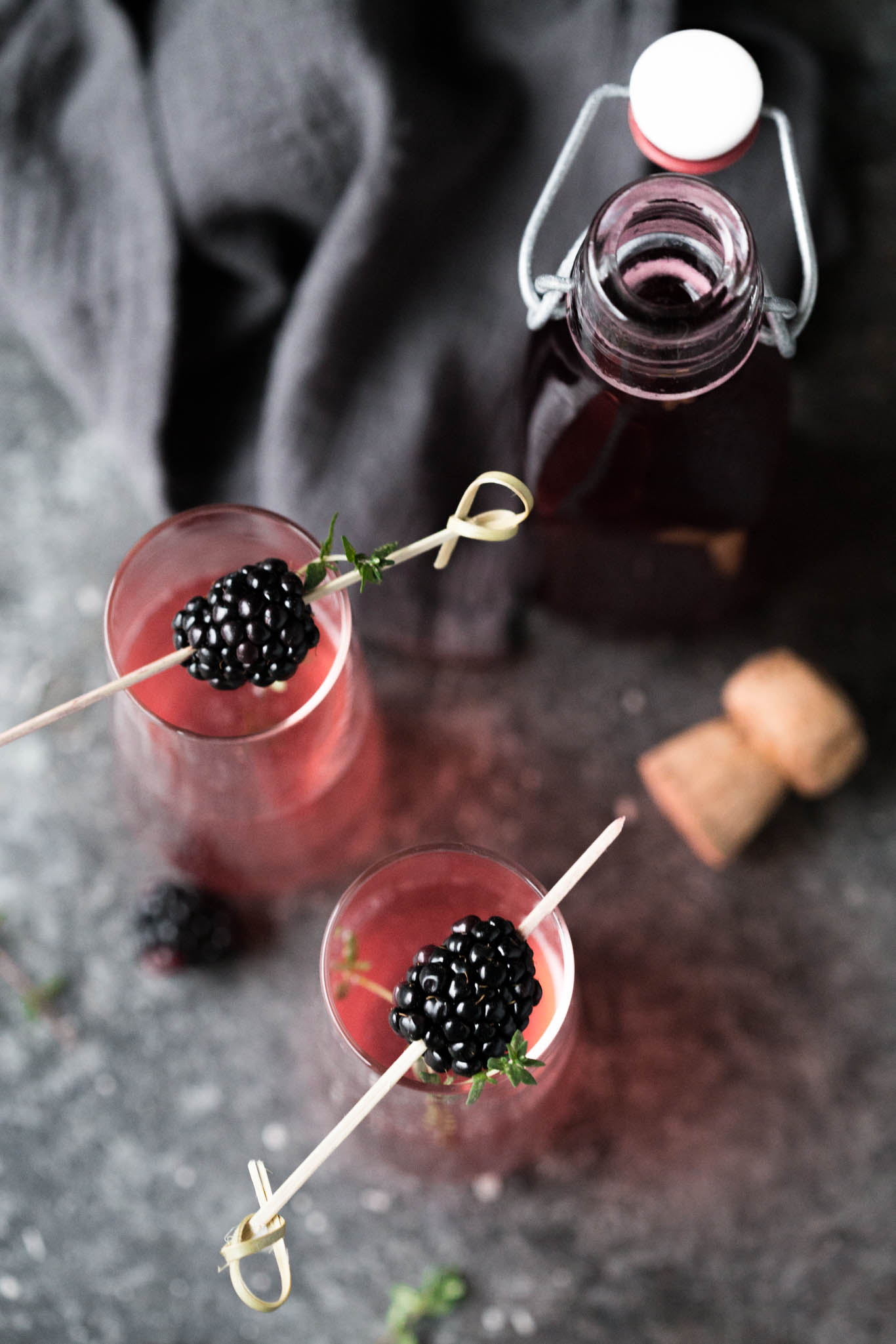 Blackberry Ginger Bellini with blackberry skewers