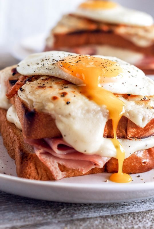 Croque Madame sandwich with runny egg on top