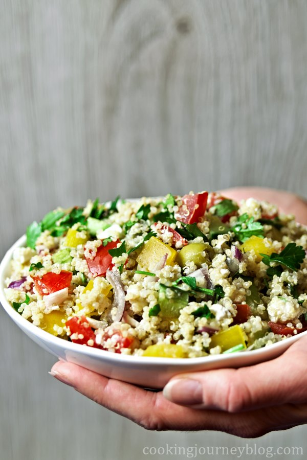 Holding a bowl with quinoa salad
