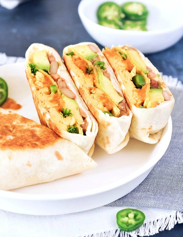 Ranchero crunchwraps, cut and served on a white plate
