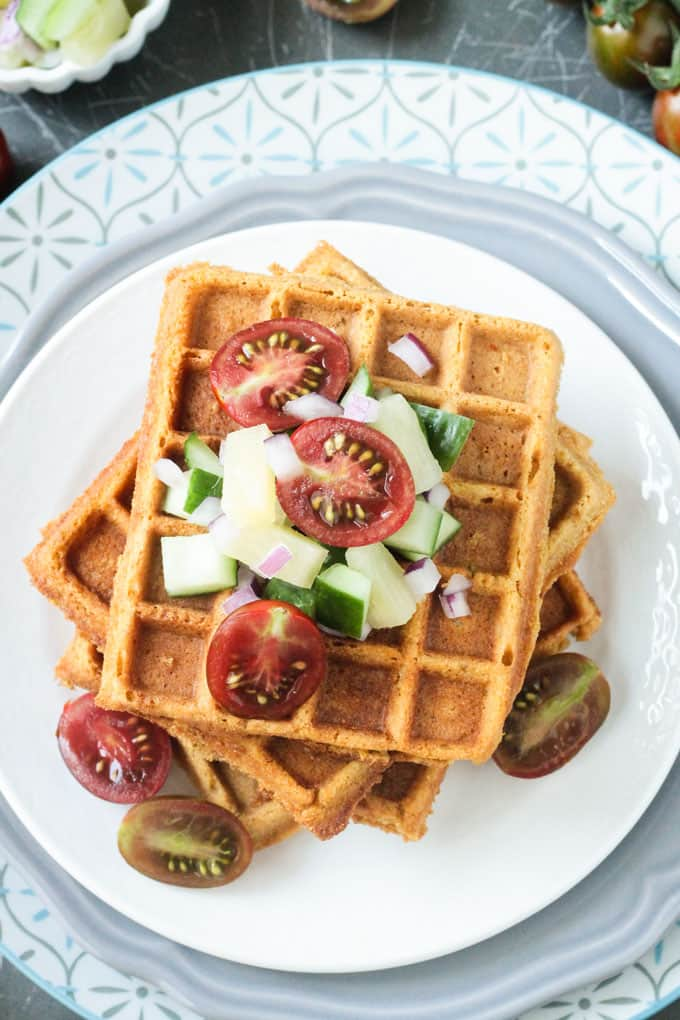 Corn waffles, served with mini tomatoes