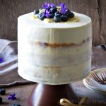 Lemon Blueberry cake , frosted and served on the cake stand