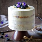 Lemon Blueberry Cake on a brow cake stand