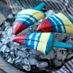 Homemade Yogurt Popsicles on the plate with ice