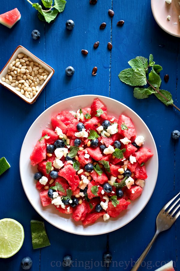 Watermelon feta salad, served with pine nuts on the side and lime for juicing