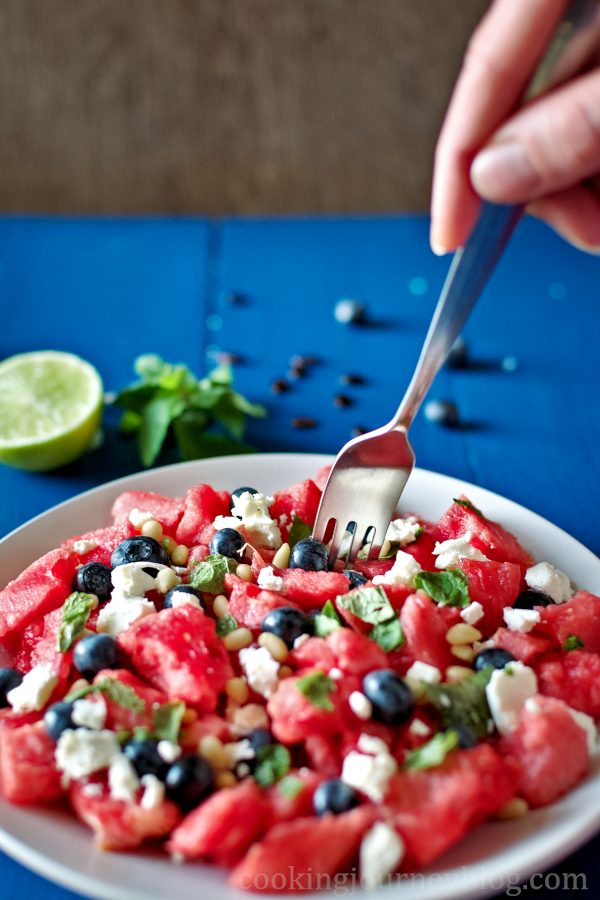 Eating watermelon feta salad with a fork