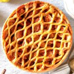 Traditional Dutch apple pie with pie crust on top.