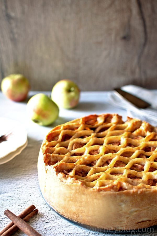 Traditional Dutch Apple Pie on the grey table with apples