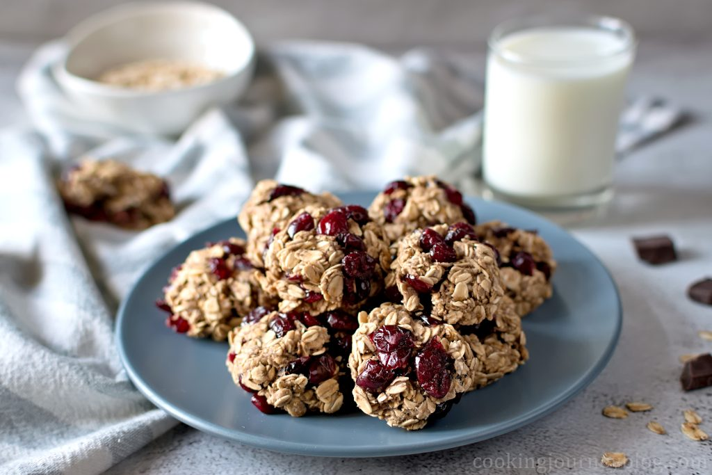 Healthy Oatmeal Cookies served on a gray plate and a glass of milk