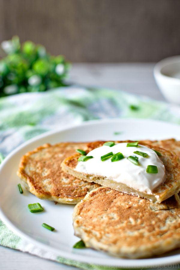 Irish potato pancakes on a plate, cut with a knife