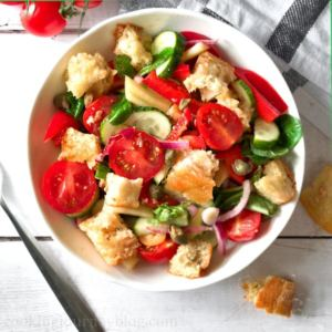 Panzanella salad in a white bowl