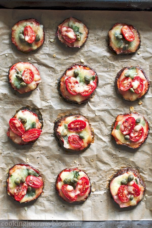 Simple eggplant pizza rounds on the baking tray just from the oven.