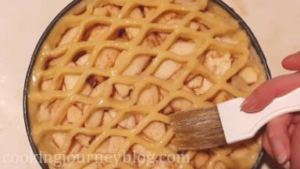 Brush the top of the pie with egg yolk.