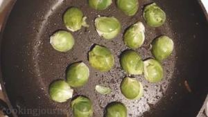 Return a pan to the heat and put in Brussels sprouts cut side down. Cook about 2 minutes until Brussels sprouts are slightly browned in the edges.