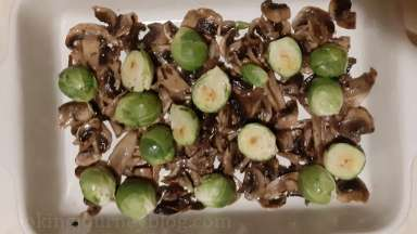 Transfer Brussels sprouts in the dish along with mushrooms.