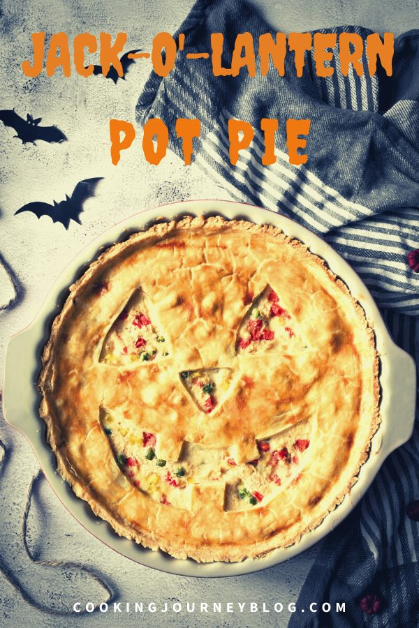 Jack-O'-Lantern Chicken Pot Pie for Halloween dinner. This pie will look spooky and fun on your Halloween table. Easy and delicious shredded chicken recipe for you family celebration.